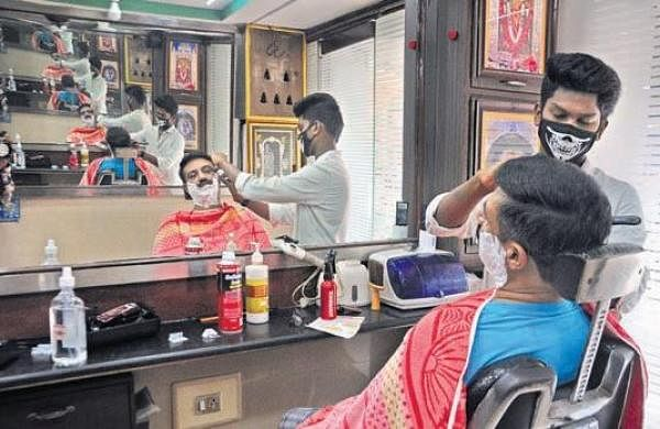 Barbers sport masks but not gloves, customers flout social distancing in Andhra Pradesh